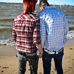 young-lesbians-holding-hands-beach